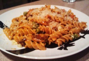 Rotini with Chorizo, Peas, and Olives in a Rosemary Tomato Cream Sauce